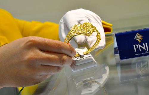 Vàng SJC và USD cùng tăng giá