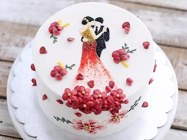 Bánh kem cưới phá cách hình cô dâu chú rể.